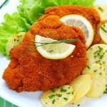 <b>4) Schnitzel with warm potato salad:</b> The first thing my friend from NY wanted to eat when he came to Germany for the first time, was Schnitzel. A big Wiener Schnitzel. The biggest one we could find. Schnitzel with warm potato salad or Pommes (chips) is probably one of the best-loved German dishes around the world. Just seeing my friend's happy contented face as he polished off the last crumb said it all. Photo: Photo: Shutterstock
