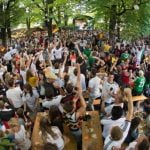 Fans watching the game in a Munich beer garden celebrate as forward Thomas Müller brings home Germany's third goal of the match.Photo: DPA