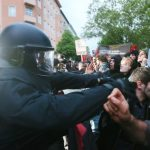 """""""National Socialism is No Alternative"""" protesters stand opposite heavily armed police. Security was tightened before the event to cope with protests and any potential threats.Photo: DPA"""