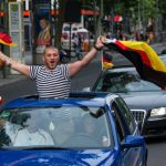 Jubilant fans in Berlin on Monday drove a convoy down the capital's Kurfürstendamm with flags waving and horns blaring.Photo: DPA