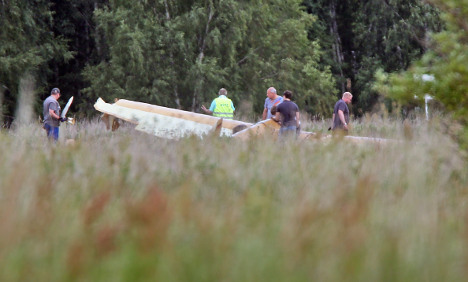 Ancient plane crashes, injuring two