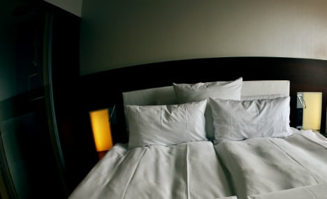 Naked woman removed from stranger's bed