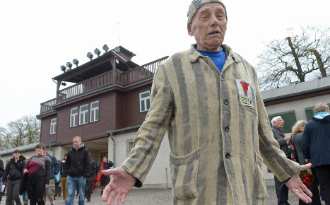 Man gives Hitler salute at concentration camp