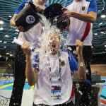 <b>Philip Heintz</b> and <b>Jan-Philip Glania</b> of Germany do the ALS Ice Bucket Challenge with national coach Henning Lambertz at the 32nd LEN European Swimming Championships 2014 at the Velodrom in Berlin, Germany.Photo: DPA