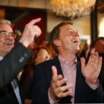 Leader of the AfD party Bernd Lucke, right, cheers for the party during the elections in Brandenburg.Photo: DPA