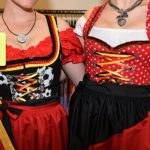 """These women need to show themselves a red card. Don't go for a """"themed"""" dirndl, be it a Christmas theme or football World Cup theme as here.Photo: DPA"""