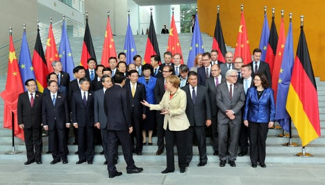 Merkel welcomes China's entire cabinet to Berlin