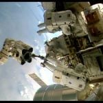 Gerst and Wiseman at work moving a failed pump module on the International Space Station.Photo: EPA/NASA TV/DPA