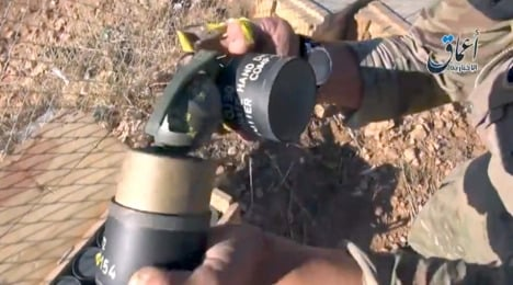 'German' hand grenades paraded by Isis in Syria