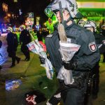 A police officer takes confiscated weapons away.Photo: DPA