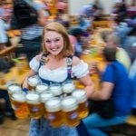 """Police reported confiscating 112,000 Maas glasses from leaving the beer tents with guests hoping to sneak off with a souvenir. Last year, there were only 81,000. We guess that's why the official Maas souvenir was the most in-demand from the trinket shops, even if the traditionalists bemoaned its design as being """"too modern"""". Photo: DPA"""