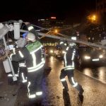Stuttgart firefighters move a downed traffic light pole off the road after storms on Tuesday night.Photo: DPA
