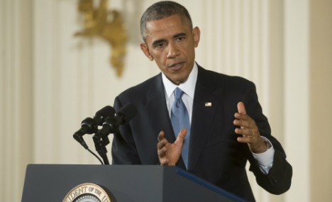 Obama: We must remember Wall lessons