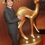 Chinese pianist Lang Lang was awarded the classical music award, though the statue he received was considerably smaller than this one that he's, er, coveting in this picture. Photo: DPA
