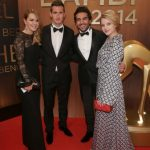 Former national football player Miroslave Klose (second left) poses with his wife Sylwia and the actors Elyas M'Barek and Jella Haase on their way into the 2014 BAMBI awards. Photo: DPA