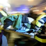 Firefighters take a weakened hunger striker for medical treatment after clearing out a hunger strike encampent in Munich's Sendlinger Tor. Photo: DPA