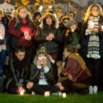 Around 1,500 people held a vigil in front of the clinic in Offenbach am Main near Frankfurt following the news that Tugce A. had been declared brain dead. Her family turned off life support on Friday. Photo: DPA