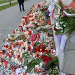 Flowers line the fence in front of the hospital in Offenbach am Main where Tugce spent her final days in a coma. More than 100,000 people have signed a change.org petition calling for the 23-year-old to be given an award for her bravery. Photo: DPA