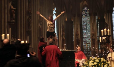 Topless cathedral protest gets day in court