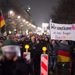 Pegida supporters in Berlin demonstrate with the Brandenburg Gate behind them. A few hundred 'Bärgida' proponents went to the streets on Monday night while 4,000 people protested against them.Photo: DPA