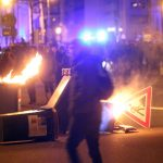 Garbage bins were lit on fire in the streets of Leipzig during a protest against the Pegida movement.Photo: DPA