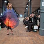 A model dons a volcano print dress for Marcel Ostertag at Berlin Fashion Week. Lucky for her, the event was indoors and there was no risk of her taking flight. Photo: DPA