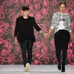 Fashion designer Jesko Wilke and model Maria Poweleit (on the right) take one last walk on the runway for Glaw's Berlin show. Photo: DPA