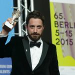 """Chilean director Pablo Lorrain holds his Silver Bear awarded for winning the Grand Jury Prize for his film, """"El Club"""". Photo: DPA"""