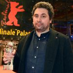 Radu Jude holds his Silver Bear for Best Director, which he won for his film Aferim. Photo: DPA