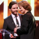"""British actor Charlotte Rampling accepts her Silver Bear for Best Actress from German actor Daniel Brühl. Rampling plays a woman in a marriage crisis in """"45 Years"""" directed by Andrew Haigh. Photo: DPA"""