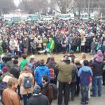 A crowd forms around a woman performing Irish step dancing at the beginning of the celebration.Photo: Emma Anderson, The Local