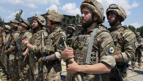Germany warns Russia off 'spiral of escalation'