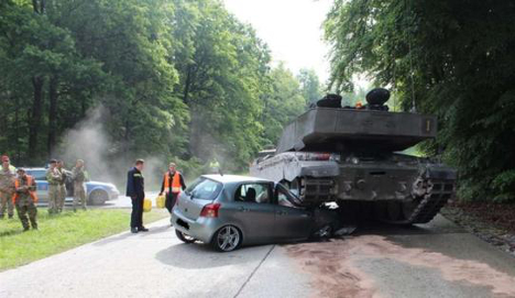 British army tank crushes learner's car