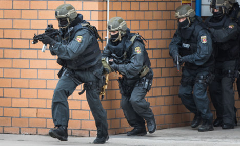 Police storm ex-officer's house as 'retribution'