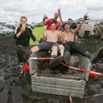 Mud and rain isn't stopping these metal fans from enjoying the start of the 25th annual Wacken Open Air festival in northern Germany.Photo: DPA