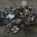 Some metal fest visitors evidently gave up on their shoes as the fest opened with rain and mud, creating a small graveyard for their soiled sneakers.Photo: DPA