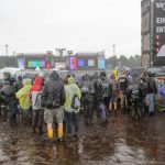 As the crowds arrived at the festival, some metal fans were already up to their ankles in mud after unusually heavy storms.Photo: Photo: DPA
