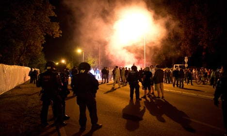 Police clash with far-right over refugees