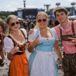 Not every one was dressed in black. Lederhosen and Dirndl were on show - accompanied of course by the sign of the horns.Photo: Photo: DPA
