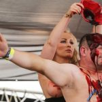 One member of the Blood Duo, a group that combines strip teases with an obsession with blood, pours fake blood over a fan's head.Photo: Photo: DPA