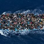 Refugees are packed onto a boat 25 kilometres from the Libyan coast in this image encapsulating the rescue operations on the Mediterranean.Photo: Massimo Sestini, Italy