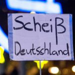Not everybody in Germany is happy that reunification took place. This sign from a left-wing Frankfurt demo reads 'shitty Germany.' The radical left say reunification day ignores the borders that Germany puts up against migrants and refugees.Photo: DPA
