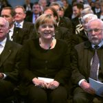 Chancellor Angela Merkel was having a great time at the event in Frankfurt, flanked by Speaker of the Bundestag Norbert Lammert, and Lothar de Maiziere, the last leader of East Germany. Photo: DPA