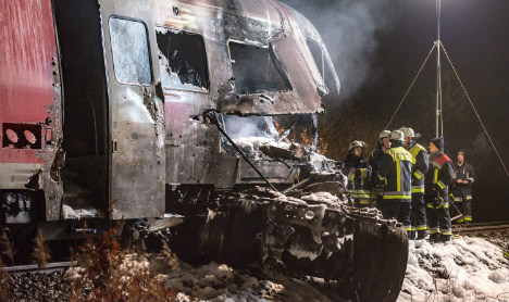 Two dead as train hits US military transport truck