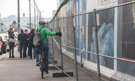 Berlin Wall fenced off to save graffiti from vandals