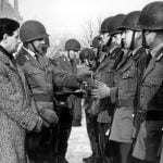 Schmidt (l) at a ceremony awarding medals to soldiers who assisted the people of Hamburg in the great flood of February 1962, while he was a local politician in the port city.Photo: DPA