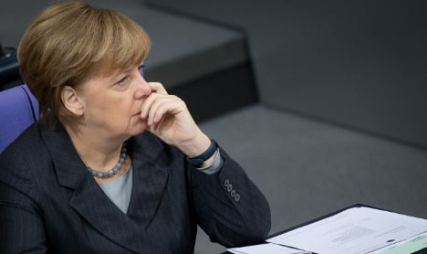 Can Merkel keep party behind her on refugees?