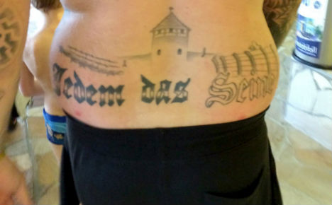 Far-right councillor gets jail term for Nazi tattoo