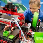 A child plays with a 3-D printer made from a modular design. This  gadget comes from Fischertechnik.Photo: Photo: DPA