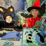 Children dressed as witch and a bat present the game Castle Flatterstein.Photo: Photo: DPA